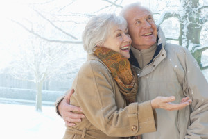Couple smiling in snow
